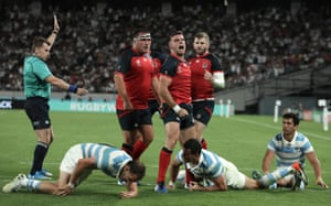 England's fly-half George Ford celebrates after scoring a try against Argentina at Tokyo Stadium.