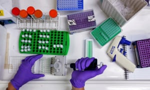 A scientist prepares protein samples for analysis in a lab at the Institute of Cancer Research in London