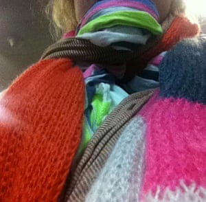 Brigid Delaney wearing several scarves from her carry-on luggage before boarding a Tigerair flight at an airport in Melbourne, Australia, in 2014. Delaney wore the scarves to reduce the weight of her carry-on luggage and thereby avoid a $200 luggage fee.