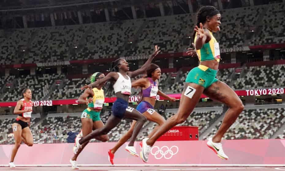 Elaine Thompson-Herah crosses the line followed by Christine Mboma of Namibia and Gabrielle Thomas of the USA