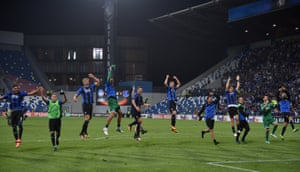 Atalanta players celebrate their victory after the final whistle.