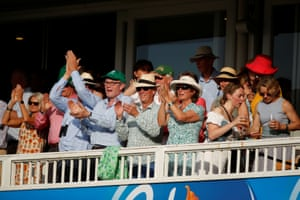 Ireland fans applaud at the end of their team's innings.
