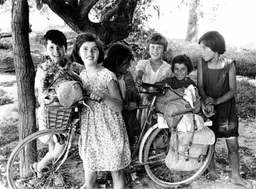 Village children with Robert's bicycle in Peć, Yugoslavia, en route to Istanbul, July 1960.
