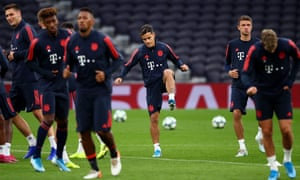 Philippe Coutinho (centre) and the Bayern Munich squad loosen up at the Tottenham stadium on Monday.