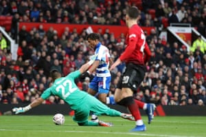 Reading's Danny Loader attempts to go around Manchester United goalkeeper Sergio Romero.