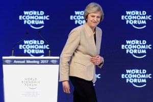 Britain's Prime Minister Theresa May leaves the stage after giving her speech today.