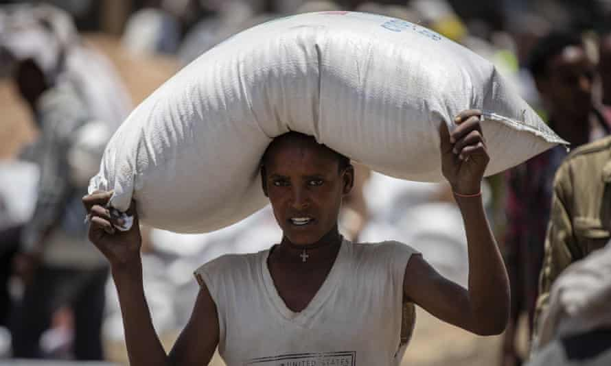 An Ethiopian man carries a donated sack of wheat in the Tigray region. The UN has warned of famine conditions in the war-torn region.