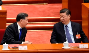 Wang Yang talks to Xi Jinping at this year's 'Two Sessions' political gathering in Beijing.