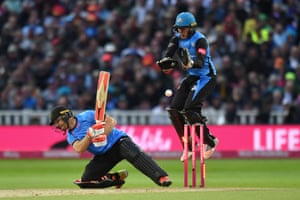 Ben Cox of Worcestershire Rapids jumps as Laurie Evans attempts the ramp shot.