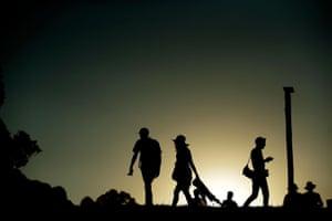 Festivalgoers at sunset