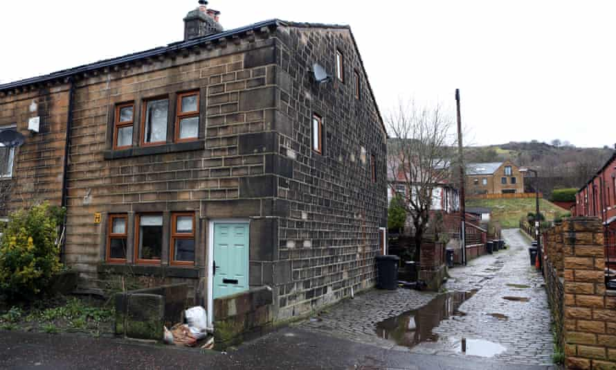 A side road which floods after much rainfall next to a house in Todmorden.