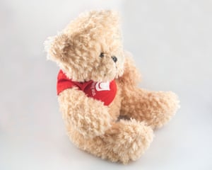 """Erica sleeps with this teddy bear her fiance, Maurice, gave her as a gift. Its shirt reads """"True love waits"""""""