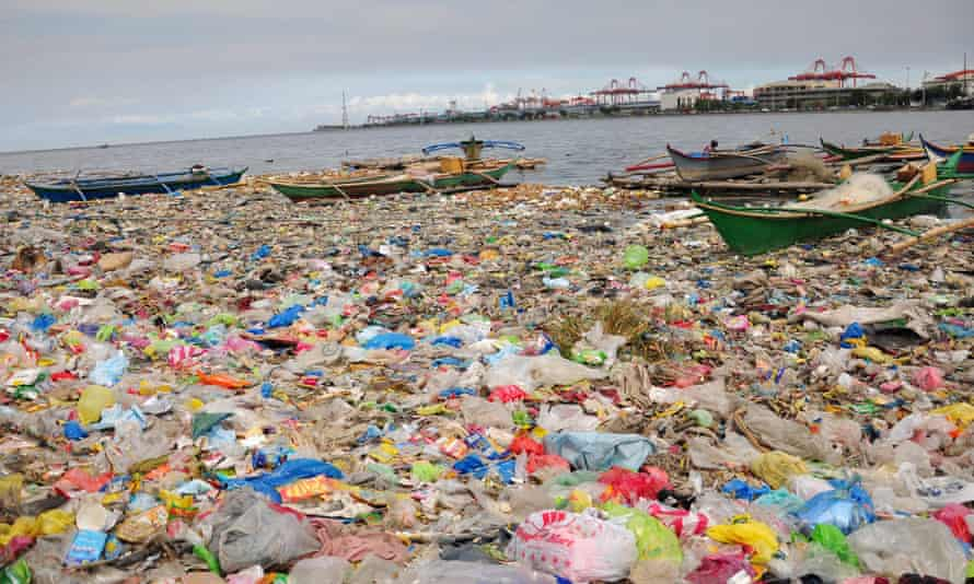 Manila Bay in the Philippines covered with plastic bags and rubbish.
