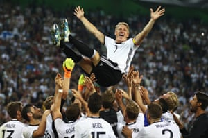 Bastian Schweinsteiger of Germany is thrown in to the air by team mates after his last international match