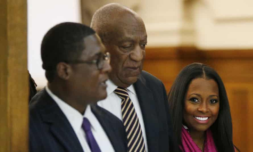 Keshia Knight Pulliam, right, an actor on The Cosby Show, walks out of the courtroom with Bill Cosby.