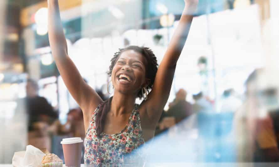 Woman cheering in a cafe