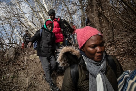 Refugees and migrants arrive at the shoreline to take a boat across the Evros River in an attempt to reach Greece from Turkey on 1 March 2020.