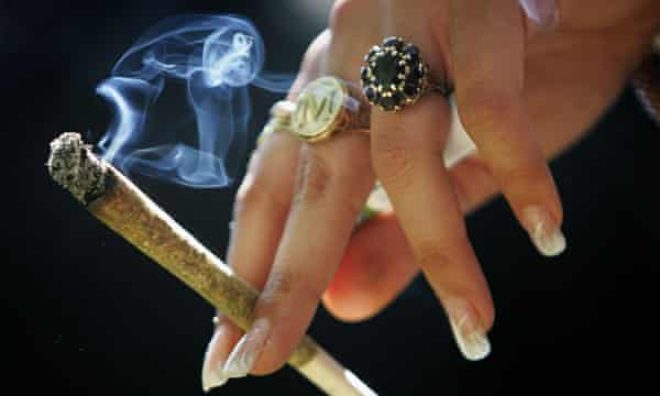 A woman holds a joint
