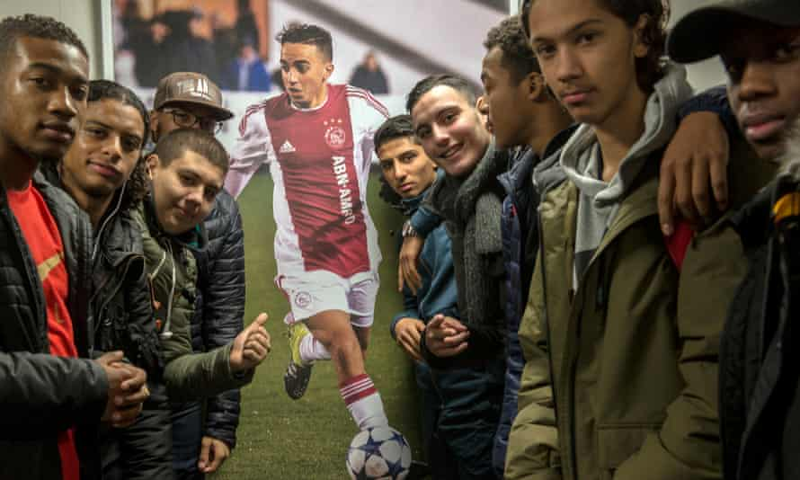 A picture of Abdelhak Nouri hangs on the wall in his former school, the Calvijn College, in Amsterdam West.