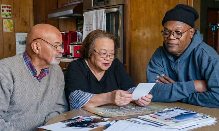 Samuel L Jackson (right) looks over a family tree with his cousins Arthur and Hilda.