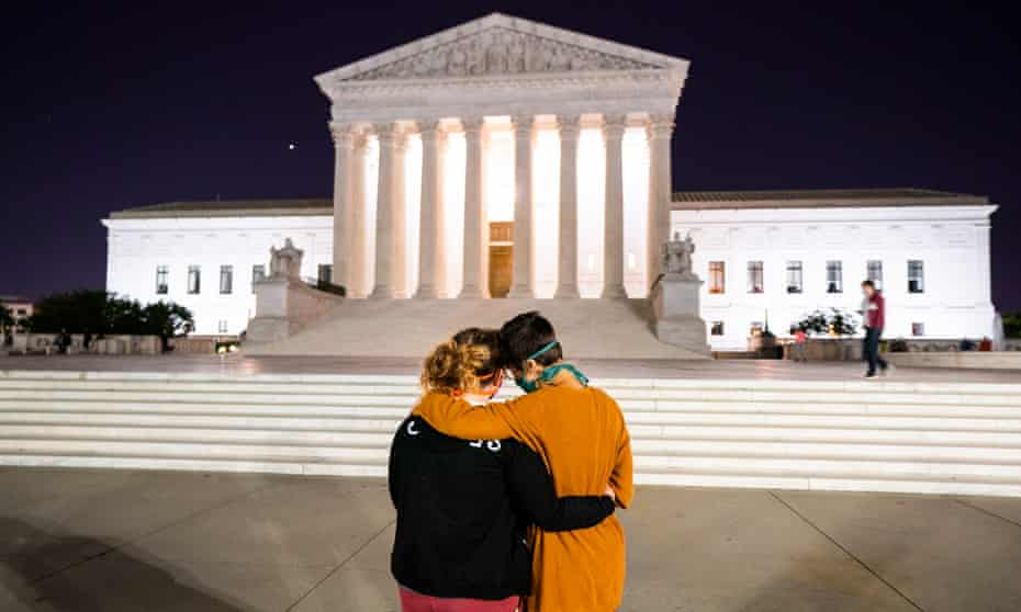 Mourners gather outside the US supreme court after the death of Ruth Bader Ginsburg on 18 September.