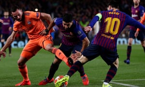 Luis Suarez barges his way through past his teammate Lionel Messi and in on goal.