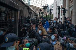 Members of the media photograph a correctional service department vehicle carrying media tycoon Jimmy Lai, founder and owner of the Apple Daily newspaper, as he left the court of final appeal.
