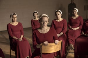 """This image released by Hulu shows Elisabeth Moss, foreground, in a scene from """"The Handmaid's Tale."""""""
