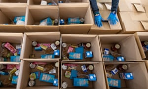 Birmingham city council staff prepare the first food parcels to be distributed to those shielding at the start of the Covid-19 lockdown.