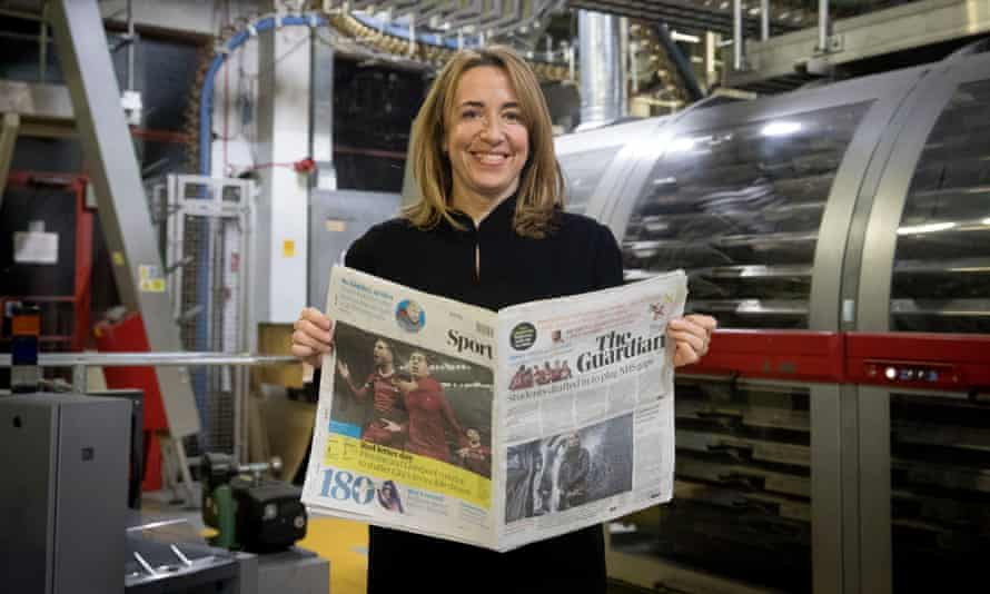 Guardian editor-in-chief Katharine Viner holding the first tabloid copy of the Guardian.