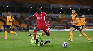 Sadio Mane skips past Rui Patricio.