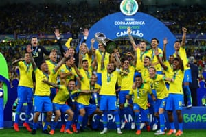 Dani Alves lifts the Copa América trophy, the 40th major honour of his career.