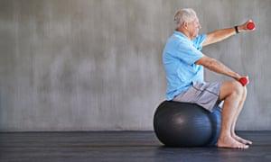 Older man sitting on a yoga ball
