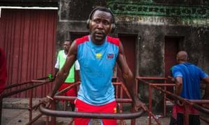 Men exercise at Tata-Raphaël stadium in Kinshasa.