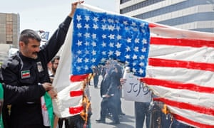 Iranian demonstrators burn a makeshift US flag during a rally in Tehran