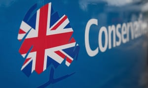 The Conservative party logo on the side of a bus