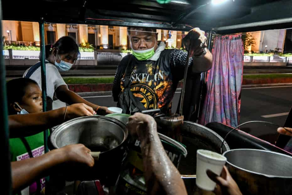 A church volunteer distributes chocolate porridge for dinner. Donations became scarce as the lockdown dragged on.