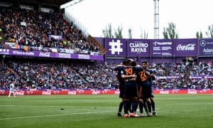 Valencia's players celebrate after scoring against Valladolid. A report has said the match was fixed but there is no suggestion the Valencia players were aware.