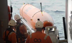 An autonomous underwater vehicle being deployed at sea by the by Ocean Infinity search ship.