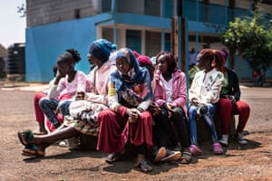 Nairobi, Kenya: girls wait to receive sanitary pads distributed by a local NGO at a primary school