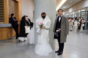 A couple arrive for the ceremony at Cheongshim Peace World Centre in Gapyeong