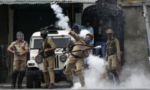 An policeman throws a tear gas shell at Kashmiri protesters demonstrating against Indian rule in Srinagar.Kashmir on Friday.