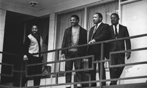 Martin Luther King Jr. stands with other civil rights leaders on the balcony of the Lorraine Motel in Memphis on April 3, 1968, a day before he was assassinated on the same balcony.