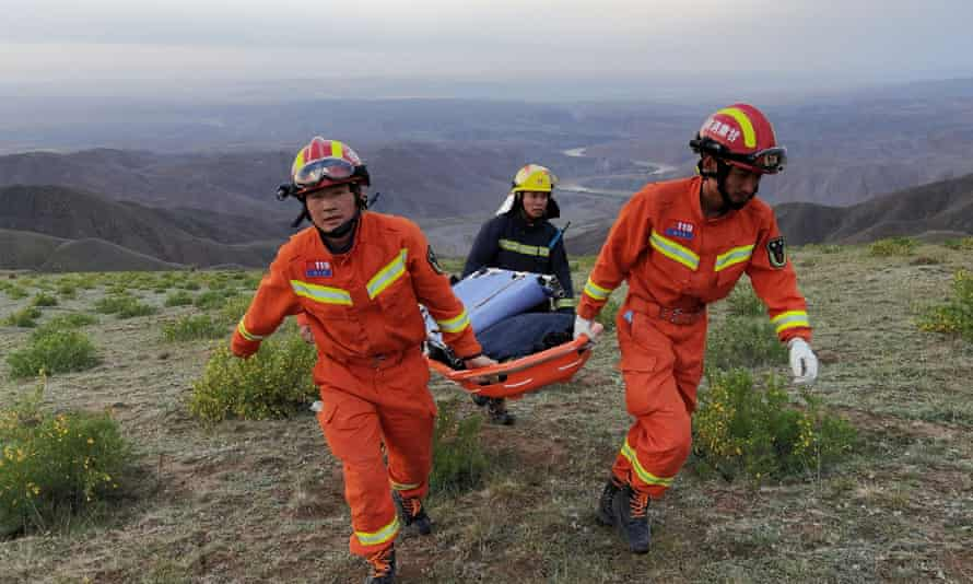 Rescue workers at the site of the ultramarathon where extreme cold weather killed participants  near Baiyin city