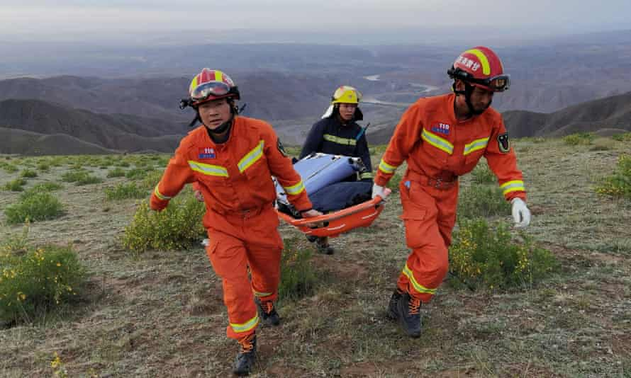 Rescue workers work at the route of the ultramarathon.