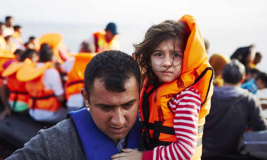Refugees arrive on Lesbos by boat from Turkey
