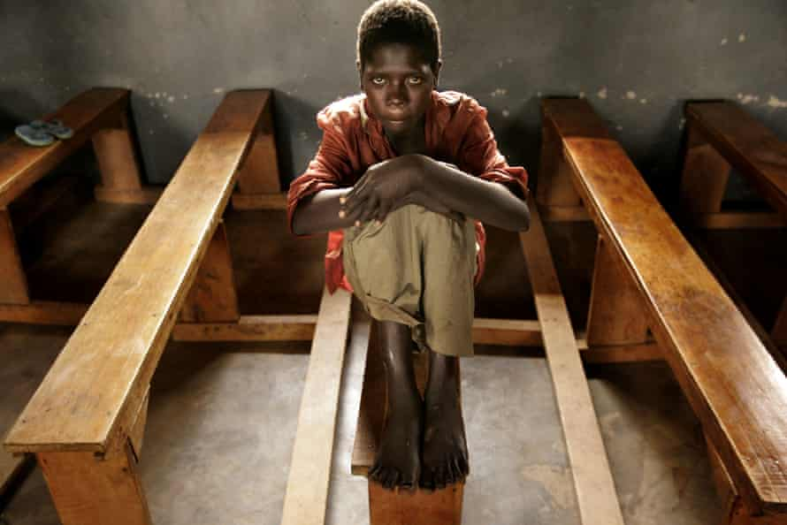 Evelyn Apio, then 13, at a camp for displaced people in Lira, northern Uganda, in 2005. She was abducted and taken to the bush for six months by the Lord's Resistance Army.