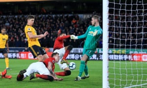 Wolves get the ball over the line for their second of the night through a combination of Leander Dendoncker and Chris Smalling to take the lead at Molineux.