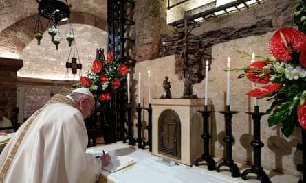 Pope Francis signs his encyclical Fratelli tutti in Assisi.