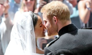 Prince Harry and Meghan Markle kiss at their wedding in May this year.